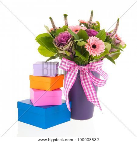 Modern blue vase with colorful bouquet and festive ribbon with gifts isolated over white background