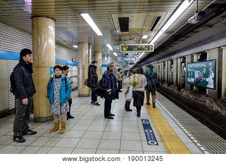 People At Subway Station In Tokyo, Japan