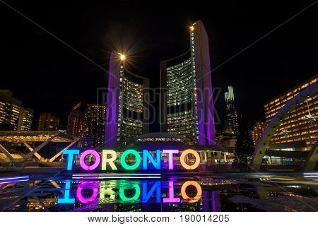 Toronto city hall and Toronto Sign at night, in Toronto, Ontario, Canada