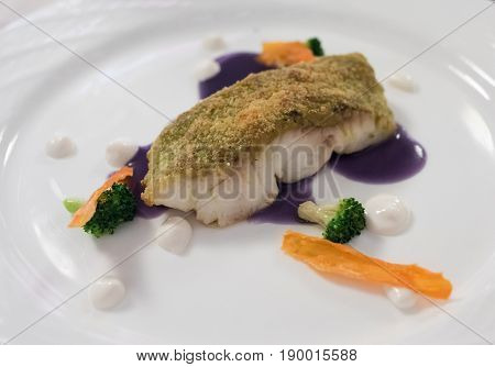 Creative Fine Dining White Fish Dish Breaded In Herbs