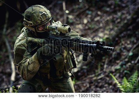 Sniper exercise in daytime exploration at forest