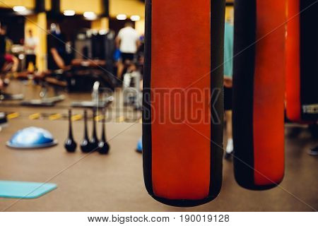 Punching bag in the gym. Against the backdrop of athletes. Gym is a cellar.