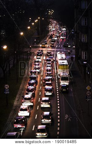 Traffic jam at evening on a street in Kracow city in Poland.