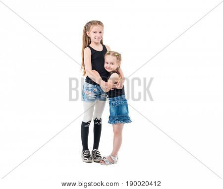 Lovely sibling sisters in jeans and black tanktops laughing and hugging each other