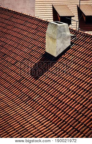 building background White chimney on a red tiled roof