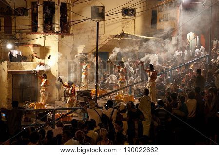 Varanasi India- 30 Jule 2011: A Hindu priest performs the Ganga Aarti ritual in Varanasi. Fire puja is a Hindu ritual that takes place at Dashashwamedh Ghat on the banks of the river Ganges