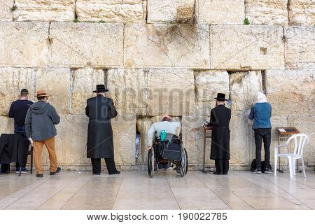 Wailing wall is the holiest place to Judaism in the old city of Jerusalem, Israel.