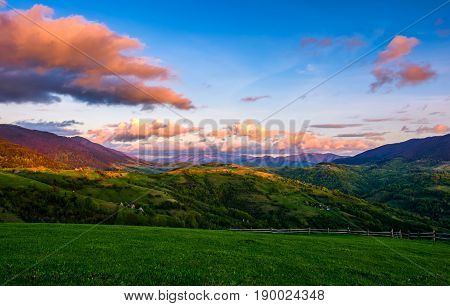 Countryside Landscape In Mountains At Sunset