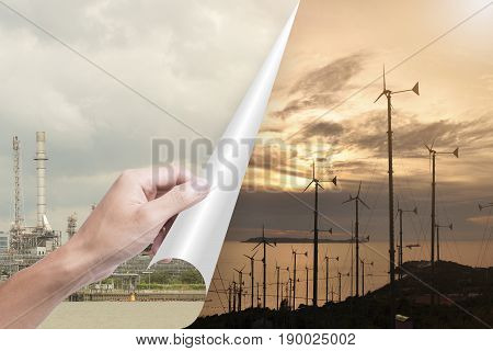 hand opening page oil industry to wind turbines. concept environment power and energy substitute.