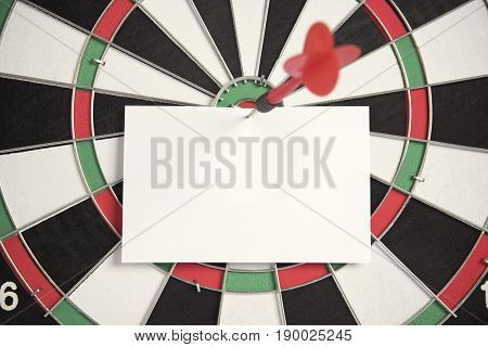 target red arrow and paper note on center of dartboard. concept business goal to marketing success. blank for input the text.