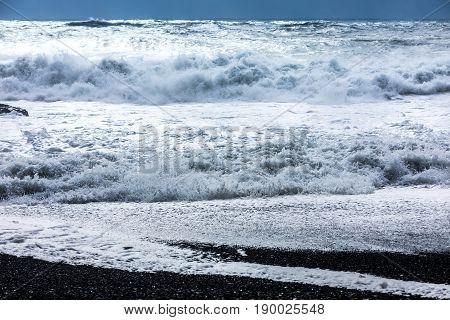 Waves On The Black Beach Of Reynisfjara In Iceland