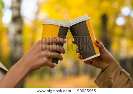 two female hands hold coffee close up