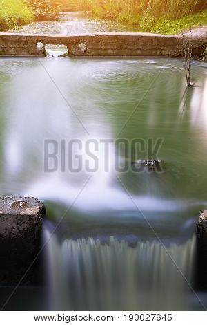 Long exposure of water stream and rocks. small waterfall with motion blur