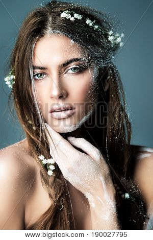Fashion and make-up concept. Portrait of a beautiful girl with art make-up. Boho style. Body painting.