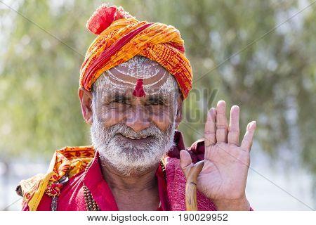 KATHMANDU NEPAL - OCTOBER 23 2016 : Portrait of Shaiva sadhu holy man in Pashupatinath Temple . Close up