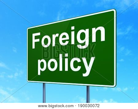 Political concept: Foreign Policy on green road highway sign, clear blue sky background, 3D rendering