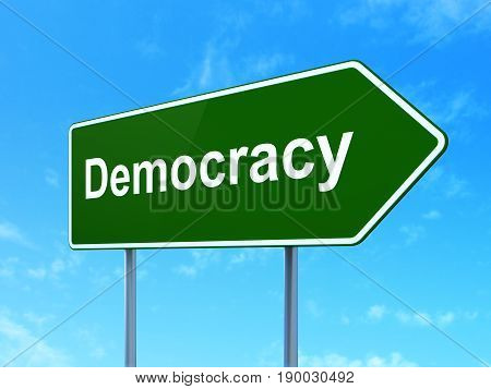 Politics concept: Democracy on green road highway sign, clear blue sky background, 3D rendering