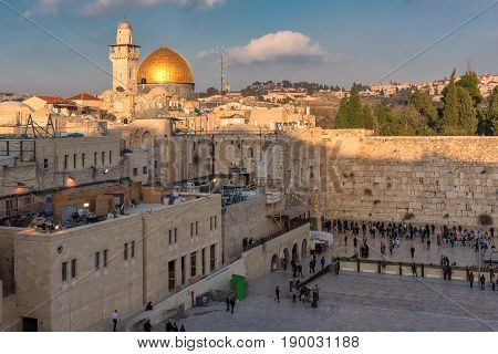 Temple Mount at sunset in the old city of Jerusalem, including the Western Wall and golden Dome of the Rock