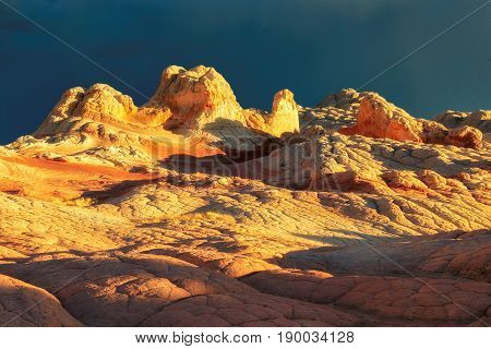 Sunset at the area of White Pocket on the Paria Plateau in Northern Arizona, USA
