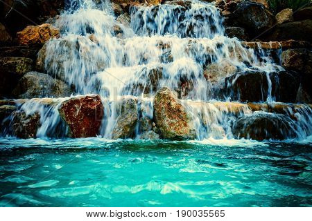 waterfall beautiful background of stone, water, moss