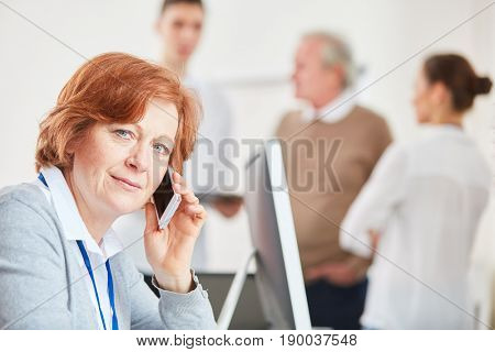 Business woman making a call to business hotline service center