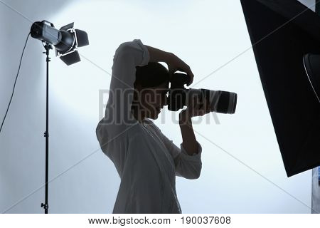 Female photographer working in studio