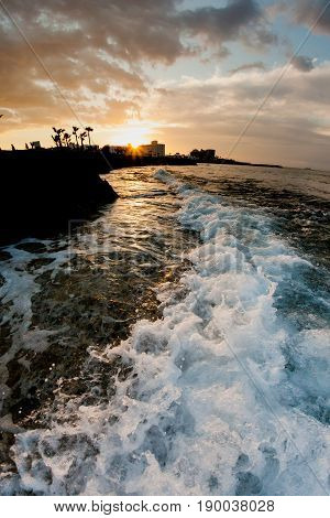 Sunset And Sea Waves In The Mediterranean Sea