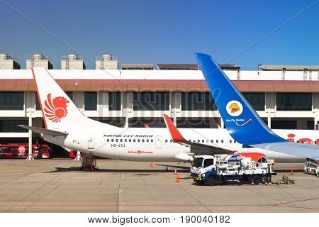 BANGKOK THAILAND-NOVEMBER 26: Nok Air and Lion Air are low cost airline plane park at Don Mueang International Airport on November 26 2016 in BangkokThailand.