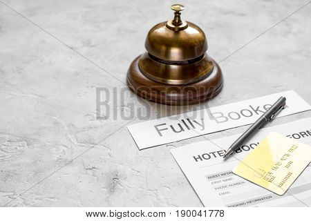 hotel reception desk with booking form on stone background