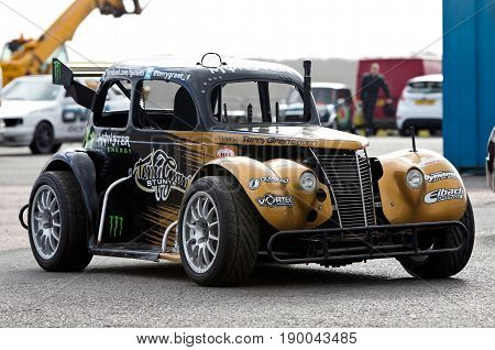 PODINGTON, UK - FEBRUARY 22: Terry Grant's demonstration stunt car stands on static display awaiting its next live arena demo at the Santa Pod Raceway Stuntfest event on February 22, 2014 in Podington