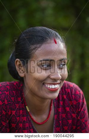 HIMALAYAS ANNAPURNA REGION NEPAL - OCTOBER 04 2016 : Portrait smiling woman in traditional dress in local village