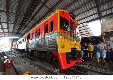 MAE KLONG THAILAND- MAY 19 2017: Diesel locomotive train stop at Mae Klong Railway Station in Mae Klong Thailand.