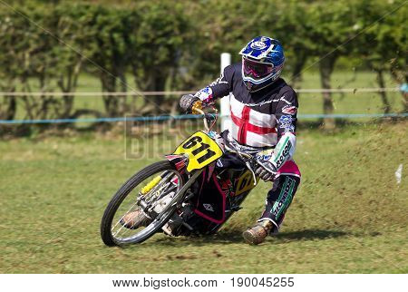 ALVELEY,UK - MAY 7: A rider competing in the Bewdley MCC spring grasstrack meeting takes the opportunity to do test runs around the circuit before the racing starts at midday on May 7, 2017 in Alveley