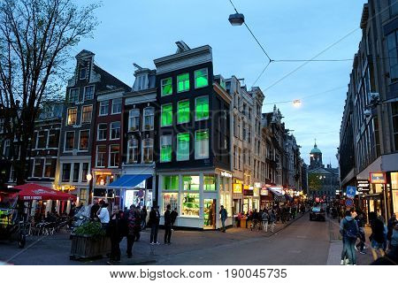 AMSTERDAM NETHERLANDS - MAY 15 2017: Amsterdam street in the evening with illumination