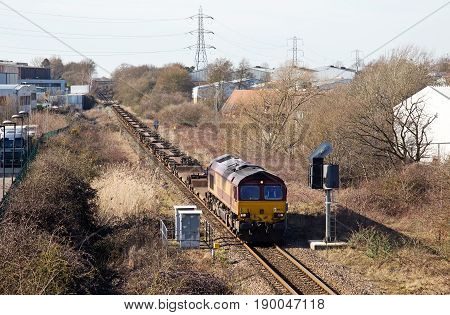 AYLESBURY, UK - MARCH 6: An MOD intermodal train sits at a red signal just outside Aylesbury loop on route to London on March 6, 2015 in Aylesbury. DBS employ 95,000 staff and turnover 19.8Bn euro p.a