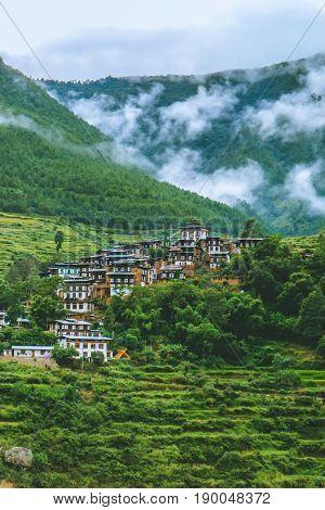Scenery near the Punakha Dzong Temple (Pungthang Dechen Phodrang Dzong - Palace of Great Happiness) Bhutan. Bhutanese village near the river at Punakha Bhutan