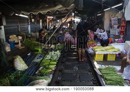 People Walking Visit And Shopping In Mae Klong Railway Market Or Talat Rom Hup Meaning The Umbrella