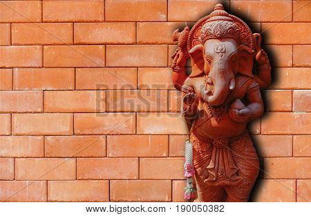 An image of a ganesha elephant god statue sculpture with old cement background