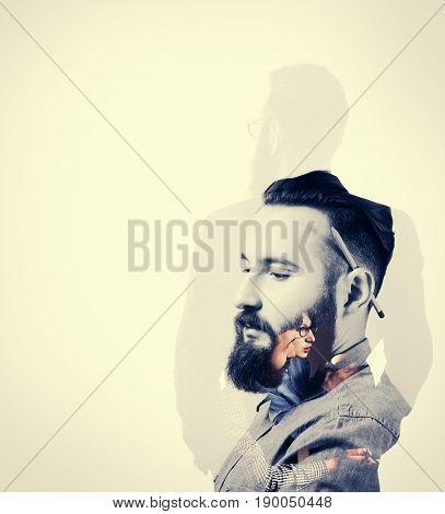 Portrait of a bearded man with a pencil behind his ear. Black and white. Image created using multiple exposures.