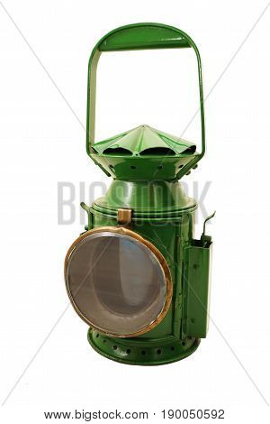 Old green signal lamp on white background
