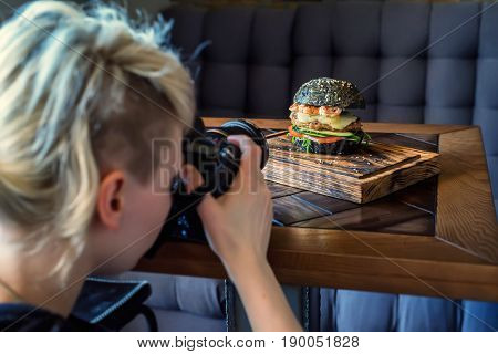 Woman food photographer shoots meal for restaurant