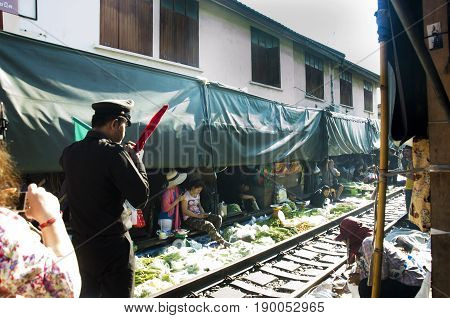 Train Station Staff Pulldown Rail Level Crossing Barriers On Road While Train Arrival At Mae Klong R