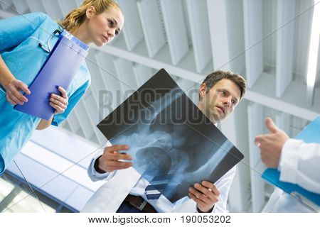 Doctors and surgeon discussing x-ray in hospital