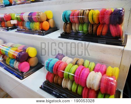 Macarons In Plastic Box For Sale At Market.