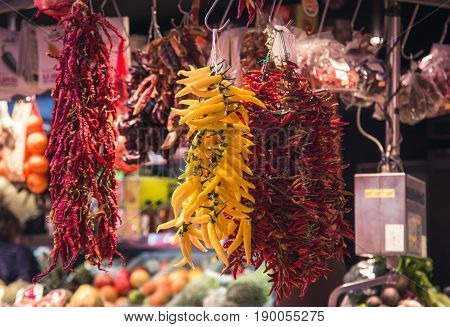 the bundles of pepper in a market
