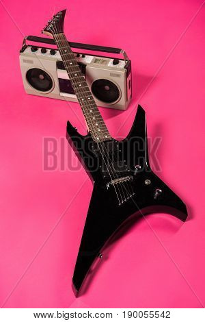 Close-up View Of Electric Guitar And Tape Recorder Isolated On Pink