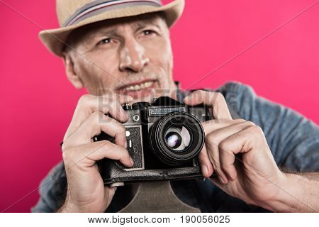 Selective Focus Of Smiling Man With Retro Photo Camera Looking Away Isolated On Pink