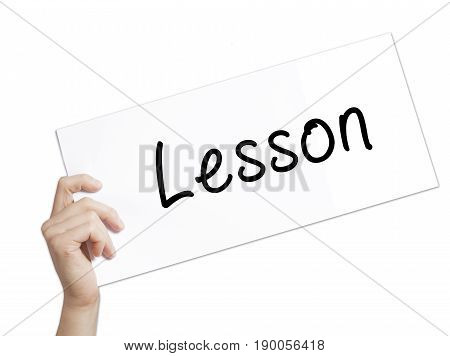 Lesson Sign On White Paper. Man Hand Holding Paper With Text. Isolated On White Background