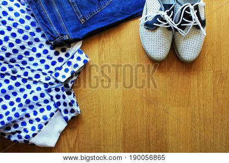 Collection of women's clothes. Jeans, shoes, bluose Top view