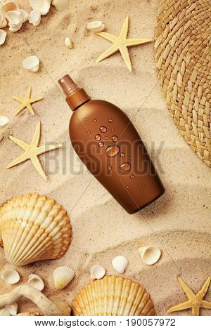 suntan lotion bottle on sand beach